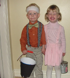 For another nursery rhyme costume, try dressing a little couple in play clothes with a bandage and water buckets to create the characters of Jack and Jill .